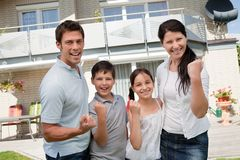 Excited family celebrating success Stock Photos