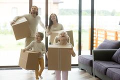 Excited family children coming into new home on moving day Stock Images