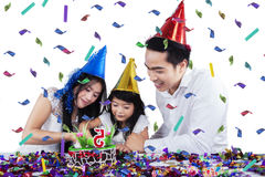 Excited family cutting birthday cake Royalty Free Stock Photos