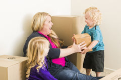 Excited Family In Empty Room Playing With Moving Boxes Stock Photography