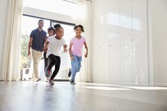 Excited Family Exploring New Home On Moving Day royalty free stock photography