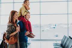 Excited family is getting ready to travel by air stock images