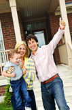 Excited family at home. Young excited family celebrating in front of new home Royalty Free Stock Photos