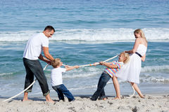 Excited family playing tug of war Stock Image