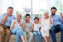 Excited family on sofa Stock Images
