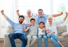 Excited family on sofa Royalty Free Stock Image