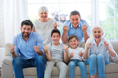 Excited family on sofa Royalty Free Stock Photography