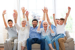 Excited family on sofa Stock Photography