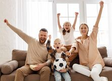 Free Excited Family Watching Football At Home Stock Images - 202026994