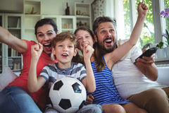 Excited family watching football match Stock Photo