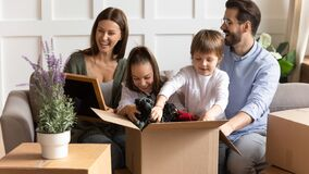 Free Excited Family With Little Kids Settle At New Home Royalty Free Stock Photos - 169721938