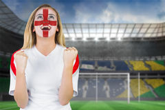 Excited fan england in face paint cheering Royalty Free Stock Image