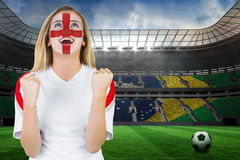 Excited fan england in face paint cheering Royalty Free Stock Photos