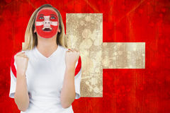 Excited fan in swiss face paint cheering Stock Photography