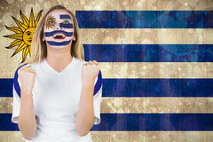 Excited fan in uruguay face paint cheering Royalty Free Stock Photography
