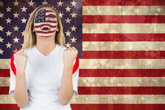 Excited fan in usa face paint cheering Royalty Free Stock Photo