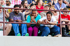 Excited fans get out their cell phones to take pictures. Stock Images