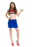Excited Fashion Model Is Pointing And Looking Away Royalty Free Stock Photos