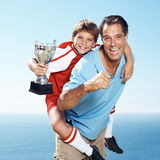 Excited father piggybacking his son Royalty Free Stock Photo