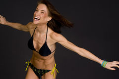 Excited Female Expresses Positively Dancing Bikini Royalty Free Stock Photography