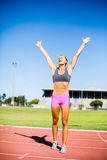 Excited female athlete posing after a victory Royalty Free Stock Images