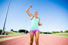 Excited female athlete posing after a victory Stock Image