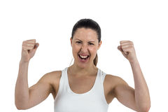 Excited female athlete posing after victory Royalty Free Stock Photo