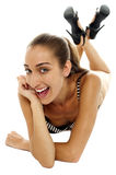 Excited female bikini model with cheeky expression Royalty Free Stock Image