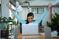 Excited female business executive looking at laptop Royalty Free Stock Photo