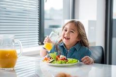 Excited female child enjoying fresh fruit beverage Royalty Free Stock Image