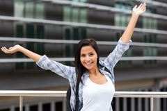 Excited female college student. Excited young female college student on campus Stock Images