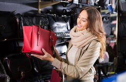 Excited female customer purchasing new handbag Stock Images