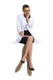 Excited Female Doctor Sitting Stock Image
