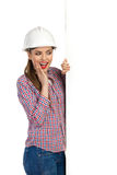 Excited Female Engineer Reading Poster Stock Photos