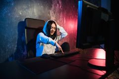 Excited female gamer girl woman pressing a button on a keyboard running a game or sending a message royalty free stock photos