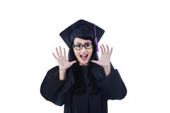 Excited female graduate screaming on white Royalty Free Stock Photo