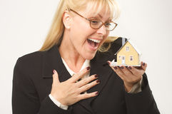 Excited Female Holding House Stock Photography
