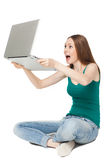 Excited female holding laptop royalty free stock image