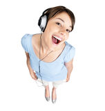 Excited female listening to music on headphones Stock Photos
