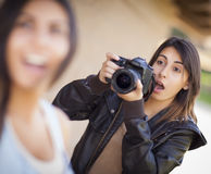 Excited Female Mixed Race Photographer Spots Celebrity Stock Photos
