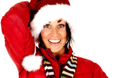 Excited female model wearing santa hat smiling Stock Photo