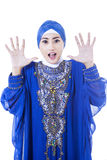 Excited female muslim in blue dress - isolated Stock Photo