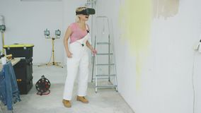 Excited female painter in virtual reality goggles stock video