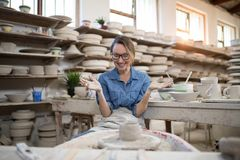Excited female potter molding a clay Royalty Free Stock Photography