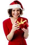 Excited female santa opening gift box Stock Image