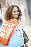 Excited Female Shopper With Sale Bags In Mall Royalty Free Stock Image