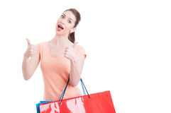 Excited female shopper showing thumbs-up Stock Photography