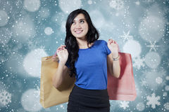 Excited female shopper with winter background Royalty Free Stock Photo