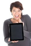 Excited female showing tablet Royalty Free Stock Images
