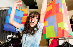 Excited female store bags Stock Photography